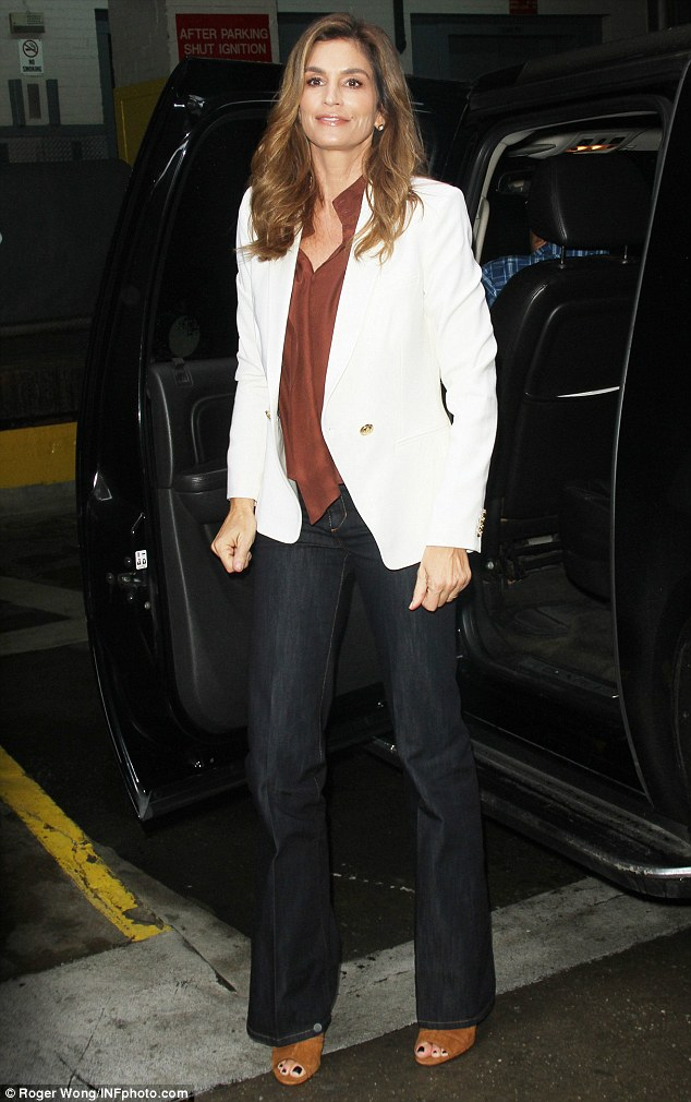 Ready to get going: The mother-of-two was seen arriving at the studios looking cheery