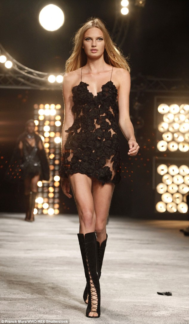 Sleek and sexy: Models wore a variation of little black dresses with lace-up suede boots