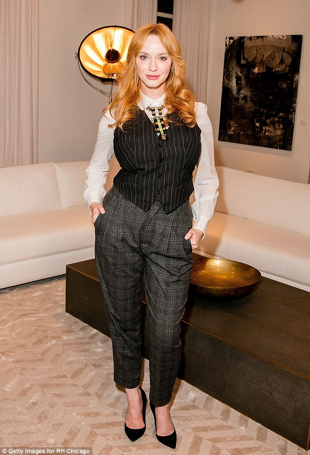 Tailored to perfection: Christina Hendricks opted for a more androgynous style when she attended the opening of a Restoration Hardware store at The Gallery at the Three Arts Club in Chicago on Wednesday night