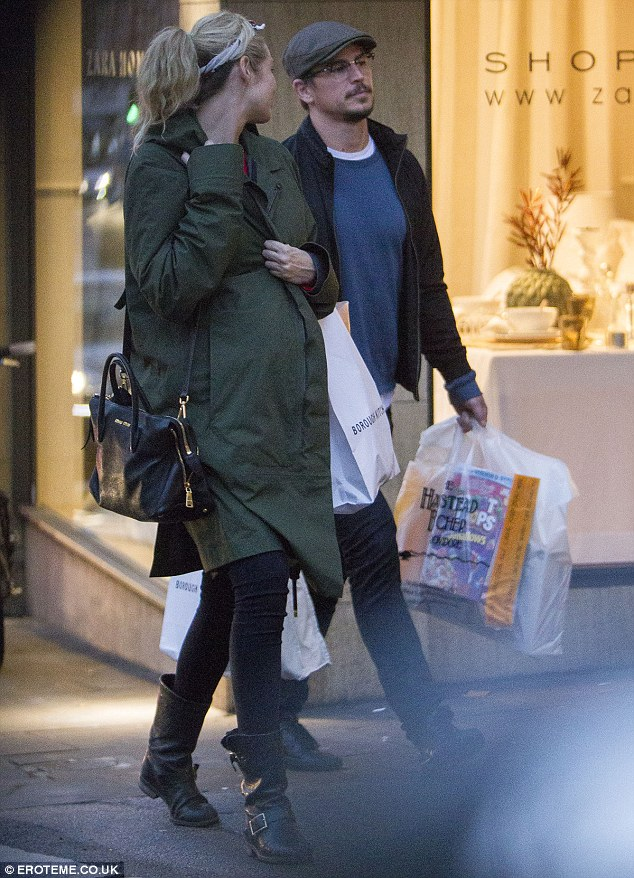 Excited times ahead: The parents-to-be emerged from a shop laden with bags