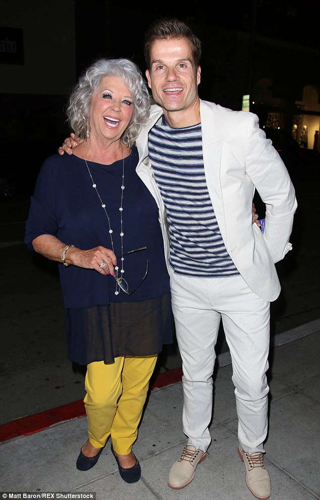 Pals: The 68-year-old TV chef was joined by her dance partnerLouis Van Amstel who looked snazzy in a white suit