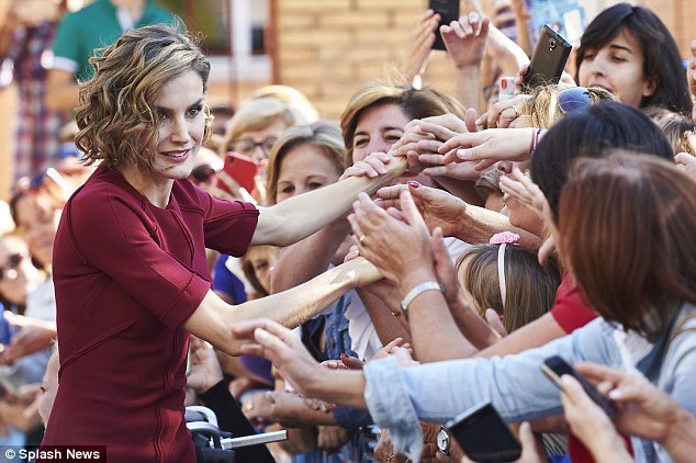 Despite looking as elegant as ever as she stepped out in Caceres today, Queen Letizia attracted some unwanted attention as she revealed her skinny arms in a slim-fitting burgundy dress