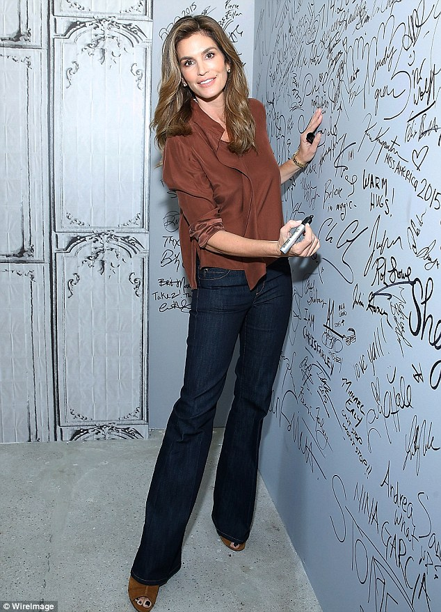 Quick scribble: Cindy, 49, took off her blazer to sign the AOL autograph wall