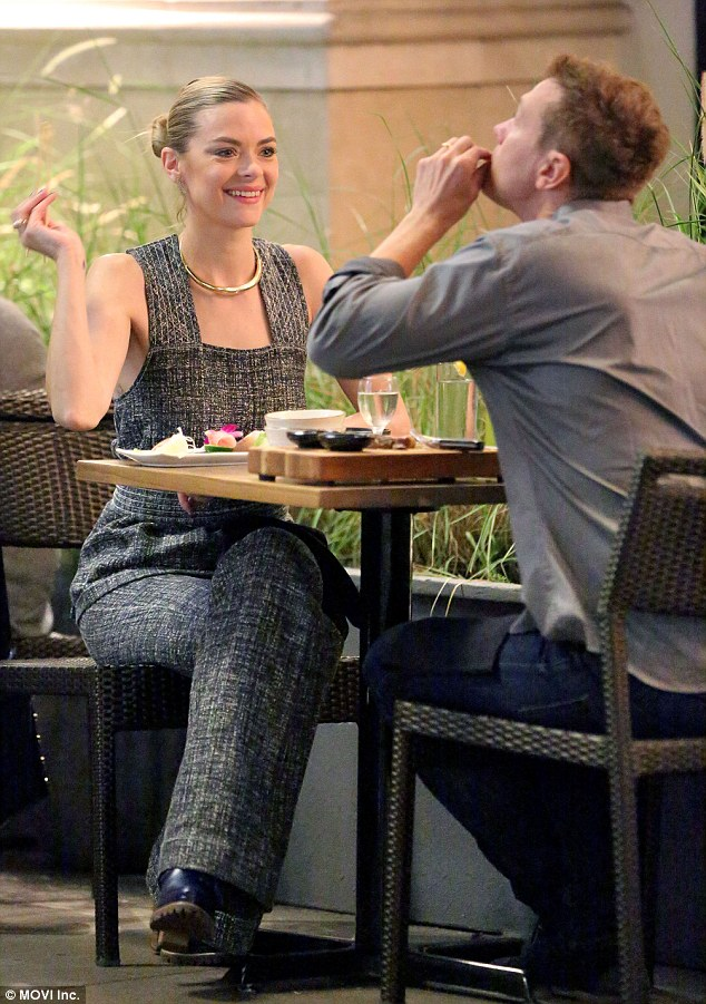 Having a laugh: On Monday she was seen playfully feeding her husband pieces of the Japanese delicacy from her own plate at Blue Ribbon Sushi at The Grove in LA