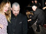 Cameron Diaz falls to the floor and gets help from Benji to get back up while Benji Madden shows off a new Head Tattoo as they leave the Nice Guy Club in West Hollywood\n\nPictured: Cameron Diaz And Benji Madden\nRef: SPL1142959  031015  \nPicture by: Photographer Group / Splash News\n\nSplash News and Pictures\nLos Angeles: 310-821-2666\nNew York: 212-619-2666\nLondon: 870-934-2666\nphotodesk@splashnews.com\n