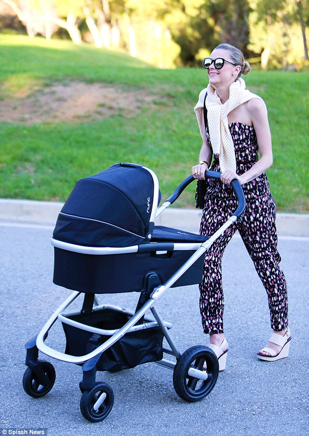 Mummy duty: Jaime King looked as though she had bounced straight back to her pre-baby body as she showcased her slim frame while out and about with baby son Leo in Los Angeles on Wednesday