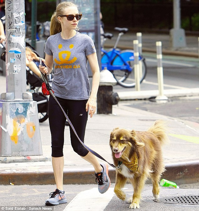 True love: Amanda is shown with her beloved dog Finn in June in New York City