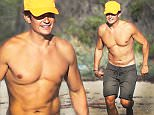Orlando Bloom got some sun, playing in the sand with surfing legend Laird Hamilton, in Malibu, on Saturday, October 3, 2015 X17online.com