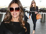 5 Oct 2015 - LOS ANGELES - USA  ELIZABETH HURLEY AT LAX   BYLINE MUST READ : XPOSUREPHOTOS.COM  ***UK CLIENTS - PICTURES CONTAINING CHILDREN PLEASE PIXELATE FACE PRIOR TO PUBLICATION ***  **UK CLIENTS MUST CALL PRIOR TO TV OR ONLINE USAGE PLEASE TELEPHONE  44 208 344 2007 ***