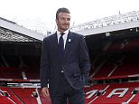 David Beckham poses for photographers at Old Trafford, ahead of his upcoming charity soccer match against a Rest of the World team led by Zinedine Zidane at Old Trafford to raise awareness and funds for UNICEF, in Manchester, Britain, October 6, 2015. REUTERS/ Andrew Yates