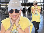 eURN: AD*183725218  Headline: Rita Ora leaving LA and new beau Travis Barker Caption: Rita Ora leaving LA flying solo leaving her new beau Travis Barker in LA. She's acting very shy wearing a baseball cap but showing the rose tattoo she's allegedly removing  October 6, 2015 X17online.com Photographer: Perez-Nic/X17online.com  Loaded on 06/10/2015 at 23:05 Copyright:  Provider: Perez-Nic/X17online.com  Properties: RGB JPEG Image (25565K 2708K 9.4:1) 2530w x 3449h at 300 x 300 dpi  Routing: DM News : GeneralFeed (Miscellaneous) DM Showbiz : SHOWBIZ (Miscellaneous) DM Online : Online Previews (Miscellaneous), CMS Out (Miscellaneous)  Parking:
