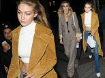 Picture Shows: Gigi Hadid  October 06, 2015    Model Gigi Hadid is seen arriving at the Four Seasons George V Hotel in Paris, France. Gigi looked casual but chic in a tan suede coat over a white crop top, jeans and white sneakers, and topped the look off with a white purse.    Non-Exclusive  WORLDWIDE RIGHTS    Pictures by : FameFlynet UK © 2015  Tel : +44 (0)20 3551 5049  Email : info@fameflynet.uk.com