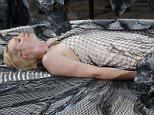 Actress Gwendoline Christie presents a creation by designer Iris van Herpen as part of her Spring/Summer 2016 women's ready-to-wear fashion show in Paris, France, October 6, 2015. REUTERS/Benoit Tessier