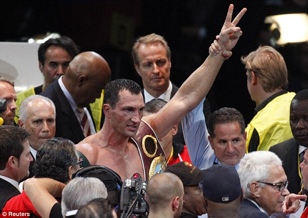 Still champion: Klitschko's heavyweight reign continues after his one-sided victory over Povetkin in Moscow