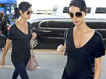 6.OCTOBER.2015 - LOS ANGELES - USA\n*AVAILABLE FOR UK SALE ONLY*\n** EXCLUSIVE ALL ROUND PICTURES **\nPREGNANT ACTRESS MORENA BACCARIN, FROM 'HOMELAND' AND 'GOTHAM', SHOWS OFF HER BABY BUMP AS SHE HEADS THROUGH LAX AIRPORT. MORENA WHO IS PREGNANT WITH GOTHAM COSTAR BEN MCKENZIE, IS CURRENTLY INVOLVED IN A MESSY DIVORCE FROM HUSBAND AUSTIN CHICK. MORENO HAS A SON WITH AUSTIN AND IS SAID TO BE ANXIOUS TO GET THE DIVORCE ORGANIZED QUICKLY SO SHE CAN MARRY BEN. NO RINGS CAN BE SEEN ON HER HAND AS SHE HEADED THRU THE AIRPORT.\nBYLINE MUST READ : XPOSUREPHOTOS.COM\n***UK CLIENTS - PICTURES CONTAINING CHILDREN PLEASE PIXELATE FACE PRIOR TO PUBLICATION ***\n*UK CLIENTS MUST CALL PRIOR TO TV OR ONLINE USAGE PLEASE TELEPHONE 0208 344 2007*