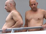 Picture Shows: Vin Diesel  October 06, 2015\n \n Actor Vin Diesel spotted relaxing on a balcony in Miami, Florida. Vin can be seen starring in 'The Last Witch Hunter' which will be released later this year.\n \n Non Exclusive\n UK RIGHTS ONLY\n \n Pictures by : FameFlynet UK � 2015\n Tel : +44 (0)20 3551 5049\n Email : info@fameflynet.uk.com
