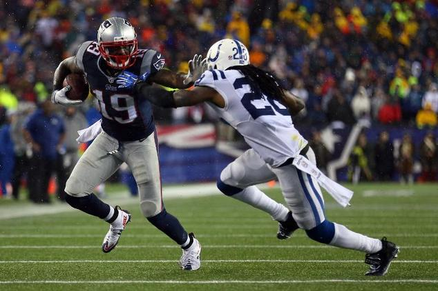 Brandon LaFell #19 of the New England Patriots runs with the ball against Greg Toler #28 of the Indianapolis Colts  on January 18, 2015 in Foxboro, Massachus...