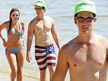 """UK CLIENTS MUST CREDIT: AKM-GSI ONLY\nEXCLUSIVE: **NO WEB UNTIL OCTOBER 6 11:30AM PST** **MUST CALL FOR PRICING**  **SHOT ON 10/2/15** Lahaina, HI - """"Fantastic Four"""" star Miles Teller enjoys a perfect afternoon in the water with sexy girlfriend, Keleigh Sperry.  The two are enjoying a much-needed vacation as it is reported that they are in town for Keleigh's sister's wedding, in which Keleigh took the role of maid of honor. Miles and Keleigh were seen having a great time sipping cocktails by the water and lounging in a private cabana after soaking themselves in the tropical waters of Hawaii. Keleigh showed off her curvaceous figure in a blue floral two-piece bikini, while Miles gazed at his girlfriend appreciatively.\n\nPictured: Miles Teller and Keleigh Sperry\nRef: SPL1144852  051015   EXCLUSIVE\nPicture by: AKM-GSI / Splash News\n\n"""