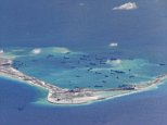 Chinese dredging vessels are purportedly seen in the waters around Mischief Reef in the disputed Spratly Islands in the South China Sea in this still image from video taken by a P-8A Poseidon surveillance aircraft provided by the United States Navy in this May 21, 2015 file photo. The United States is expected to sail warships close to the artificial islands in the next two weeks to signal it does not recognize Chinese territorial claims over the area, according to media reports citing a senior U.S. Official.  REUTERS/U.S. Navy/Handout via Reuters ATTENTION EDITORS - THIS PICTURE WAS PROVIDED BY A THIRD PARTY. REUTERS IS UNABLE TO INDEPENDENTLY VERIFY THE AUTHENTICITY, CONTENT, LOCATION OR DATE OF THIS IMAGE. THIS PICTURE IS DISTRIBUTED EXACTLY AS RECEIVED BY REUTERS, AS A SERVICE TO CLIENTS. EDITORIAL USE ONLY. NOT FOR SALE FOR MARKETING OR ADVERTISING CAMPAIGNS - RTX1DZN7