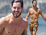 EXCLUSIVE: The Dancing With The Stars champ  Valentin Chmerkovskiy - who won the last season of the show with Rumer Willis - took a rare break from rehearsals to hit the beach in these rather loud shorts.\nThis season Val is paired with singer Tamar Braxton and hit a high note with 27 / 30 for their most recent dance.\n\nPictured: Valentin Chmerkovskiy\nRef: SPL1145217  071015   EXCLUSIVE\nPicture by: Deano / Splash News\n\nSplash News and Pictures\nLos Angeles: 310-821-2666\nNew York: 212-619-2666\nLondon: 870-934-2666\nphotodesk@splashnews.com\n