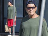 EXCLUSIVE: Charlie Sheen picks up groceries in Malibu,CA. Charlie wore red shorts, a long sleeved green t-shirt and a baseball cap foe the early morning shop.