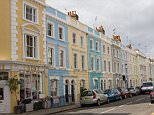 Colourful terraced houses in Portland Road Kensington and Chelsea London W11. Image shot 2008. Exact date unknown.
