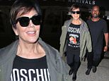 Kris Jenner and Corey Gamble arrive from Paris after spending time watching Kendall walk the runways during PFW. October 7, 2015  X17online.com