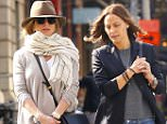 10/08/2015 EXCLUSIVE: Jennifer Aniston and a friend take a walk in NYC on a beautiful fall day. Jennifer was wearing a dark fedora and blue jeans. Showing beautiful engagement ring while strolling unnoticed in lower Manhattan. sales@theimagedirect.com Please byline:TheImageDirect.com *EXCLUSIVE PLEASE EMAIL sales@theimagedirect.com FOR FEES BEFORE USE