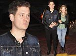 07.OCTOBER.2015 - BUENOS AIRES - ARGENTINA\nMICHAEL BUBLE AND HIS WIFE LUISANA LOPILATO WHO ARE EXPECTING THEIR SECOND CHILD ENJOY A NIGHT OUT AT THE HAPPENING RESTAURANT. THE LOVELY COUPLE SMILE AND WAVE TO THE PHOTOGRAPHERS.\n*AVAILABLE FOR UK SALE ONLY*\nBYLINE MUST READ : XPOSUREPHOTOS.COM\n***UK CLIENTS - PICTURES CONTAINING CHILDREN PLEASE PIXELATE FACE PRIOR TO PUBLICATION ***\n**UK CLIENTS MUST CALL PRIOR TO TV OR ONLINE USAGE PLEASE TELEPHONE  44 208 344 2007 ***