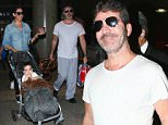 Simon Cowell looks desheveled with a beard as he travels with his partner, Lauren Silverman & their adorable son, Eric Cowell.  The former American Idol judge was seen casually dressed at LAX as Lauren pushed their adorable son in a stroller. \n\nPictured: Simon Cowell, Lauren Silverman, Eric Cowell\nRef: SPL1146759  071015  \nPicture by: Splash News\n\nSplash News and Pictures\nLos Angeles: 310-821-2666\nNew York: 212-619-2666\nLondon: 870-934-2666\nphotodesk@splashnews.com\n