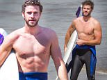 EXCLUSIVE: **PREMIUM EXCLUSIVE RATES APPLY** **NO WEB UNTIL 1AM PST, OCTOBER 8th** Liam Hemsworth goes surfing in Phillip Island.\nLiam Hemsworth was spotted back in his home town of Phillip Island, located on the South East Coast of Victoria.\nLiam was seen surfing at Smith's beach with a male friend, later getting out of the water pulling his wetsuit half off to show off his torso.\nLiam was seen walking with a slight limp and putting out his knee to his friend as if he had injured himself in some way.\nLiam stopped off to have a quick shower before leaving the beach\n\nPictured: Liam Hemsworth\nRef: SPL1144881  071015   EXCLUSIVE\nPicture by: Splash News/Media Mode\n\nSplash News and Pictures\nLos Angeles:310-821-2666\nNew York:212-619-2666\nLondon:870-934-2666\nphotodesk@splashnews.com\n