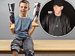 A 10-year-old amputee who had his prosthetic legs customised with the face of his 'hero' Eminem on them has received a signed album from the American rapper - who spotted a photo of the youngster's unique tribute on Twitter. \nDetermined Teejay Stainer was told he might never walk when he was born without a calf bone in his right leg and credits the lyrics of hip hop star Eminem, also known as Slim Shady, for making him feel 'brave' enough to defy expectations.  \nHe has been a fan of the hit maker - who famously sang the line: 'will the real Slim Shady please stand up?'  - since he was two, when his parents Georgina and Richard Stainer would play it to help him sleep. \n© Solent News & Photo Agency\nUK +44 (0) 2380 458800