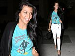 Please contact X17 before any use of these exclusive photos - x17@x17agency.com   Single mom Kourtney Kardashian arriving at La Scalia in ripped white denim and a vintage Michael Jackson tee ariving to dinner with a friend looking radiant and happy to have a night off.   October 7, 2015  X17online.com