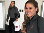 Headline: Tough girl Ronda Rousey smiling and casual at LAX Caption: MMA champion Ronda Rousey was spotted at LAX in a hoodie and tights, traveling casual in LA, on Thursday, October 8, 2015 X17online.com Photographer: Nichole-Perez/X17online.com  Loaded on 08/10/2015 at 23:09 Copyright:  Provider: Nichole-Perez/X17online.com  Properties: RGB JPEG Image (5805K 537K 10.8:1) 1200w x 1651h at 300 x 300 dpi  Routing: DM News : GeneralFeed (Miscellaneous) DM Showbiz : SHOWBIZ (Miscellaneous) DM Online : Online Previews (Miscellaneous), CMS Out (Miscellaneous)  Parking:
