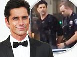LOS ANGELES, CA - SEPTEMBER 20: Actor John Stamos arrives at the 67th Annual Primetime Emmy Awards at the Microsoft Theater on September 20, 2015 in Los Angeles, California. (Photo by Dan MacMedan/WireImage)