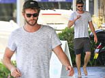 LIAM HEMSWORTH SPOTTED HEADING OUT FOR LUNCH IN HIS HOMETOWN ON PHILLIP ISLAND. BACK INTO THE LOCAL WAY OF THINGS, LIAM LOOKED SUPER CASUAL, WALKING BAREFOOT OUT OF A CAFE.\n8 October 2015\n©MEDIA-MODE.COM