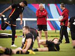 Wales' head coach Warren Gatland (C) smiles during a training session at London Irish Amateur Rugby Football Club in Sunbury on October 8, 2015 during the 2015 Rugby World Cup. Wales will play Australia on October 10, 2015 at Twickenham stadium.   AFP PHOTO / LIONEL BONAVENTURELIONEL BONAVENTURE/AFP/Getty Images