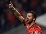 Portugalís Joao Moutinho celebrates after scoring the opening goal during the Euro 2016 qualifying group I soccer match between Portugal and Denmark at the Municipal Stadium in Braga, Portugal, Thursday, Oct. 8 2015. (AP Photo/Paulo Duarte)