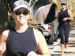 Reese Witherspoon sports a bandage on her right shoulder as she keeps fit with a girlfriend during their morning run in Brentwood. October 8, 2015 X17online.com