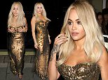 Rita Ora seen arriving at sexy fish restaurant in a sparkly gold dress ahead of her performance.\nFeaturing: Rita Ora\nWhere: London, United Kingdom\nWhen: 09 Oct 2015\nCredit: WENN.com