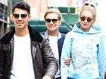 NEW YORK, NY - OCTOBER 09:  ModelYolanda Foster,Joe Jonas and Gigi Hadid are seem walking in Soho  on October 9, 2015 in New York City.  (Photo by Raymond Hall/GC Images)