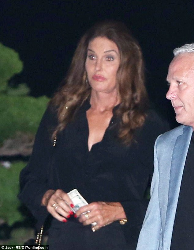 Dollar, dollar bills! Caitlyn flaunted her perfectly manicured red nails as she held on to a wad of cash outside of the restaurant