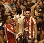 Filling the streets: Atletico Madrid fans hit the Neptuno fountain to celebrate after their club won the La Liga title by drawing 1-1 with Barcelona in the Nou Camp