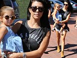 Kourtney Kardashian was accompanied by friends as she carried daughter Penelope into lunch at Taverna Tony, on Friday, October 9, 2015 X17online.com