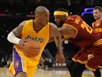 Los Angeles Lakers guard Kobe Bryant (24) drives to the basket against Cleveland Cavaliers forward LeBron James (23) in the second half of the NBA game at Staples Center. Richard Mackson-USA TODAY Sports