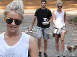 10/10/2015\nEXCLUSIVE: Julianne Hough and soon to be husband Brooks Laich go for a hike in the parklands near the nations capital. The Dancing with the Stars judge and Professional Hockey player looked to be enjoying the beautiful fall weather while taking Julianne's two dogs for a walk on the trails. The couple announced their engagement via Instagram on August 18th of this year. With the exception of a Red Carpet event on September 1st this is the first time the couple has been spotted together in public since the news of the engagement.\nsales@theimagedirect.com Please byline:TheImageDirect.com\n*EXCLUSIVE PLEASE EMAIL sales@theimagedirect.com FOR FEES BEFORE USE
