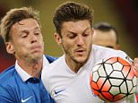 LONDON, ENGLAND - OCTOBER 09 :  Aleksandr Dmitrijev of Estonia and Adam Lallana of England in action during the UEFA Euro 2016 Qualifier match between England and Estonia at Wembley Stadium on October 9, 2015 in London, England.  (Photo by Matthew Ashton - AMA/Getty Images)