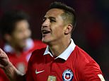 Chile's Alexis Sanchez celebrates after scoring against Brazil during their Russia 2018 FIFA World Cup qualifiers match, at the Nacional stadium in Santiago de Chile, on October 8, 2015.   AFP PHOTO / MARTIN BERNETTIMARTIN BERNETTI/AFP/Getty Images