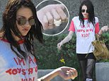 """EXCLUSIVE: ** PREMIUM RATES APPLY** **STRICTLY NO WEB UNTIL 6PM PST OCT 9TH 2015** Kurt Cobain's daughter Frances Bean Cobain was this week photographed for the first time since she reportedly got married.\nThe 23-year-old was seen walking into an office block in Cyprus, California at 1pm on Thursday after being driven there from her home in the Hollywood Hills by a long-haired companion, who closely resembled her new husband Isaiah Silva.\nWearing a white and red T Shirt with the words """"I'm a Toys """"R"""" Us kid, black Moschino fishnet skirt, Frances appeared to be wearing a silver wedding band on her ring finger.\nAn onlooker said: """"To say she had just got married, Frances didn't look too happy as she entered the building, in fact she looked quite sad and miserable.""""\nWhile Frances spent around 45 minutes in the office building, the man waited for her outside in a  silver Prius, before the pair drove off.\n\nPictured: Frances Bean Cobain\nRef: SPL1147471  091015   EXCLUSIVE"""