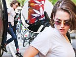 Picture Shows: Kristen Stewart  October 08, 2015\n \n 'Twilight' actress, Kristen Stewart, is spotted out and about in New York City, New York. \n \n Kristen could be seen wearing a shirt with holes in it and a pair of marijuana leaf socks.\n \n Exclusive - All Round\n UK RIGHTS ONLY\n \n Pictures by : FameFlynet UK © 2015\n Tel : +44 (0)20 3551 5049\n Email : info@fameflynet.uk.com